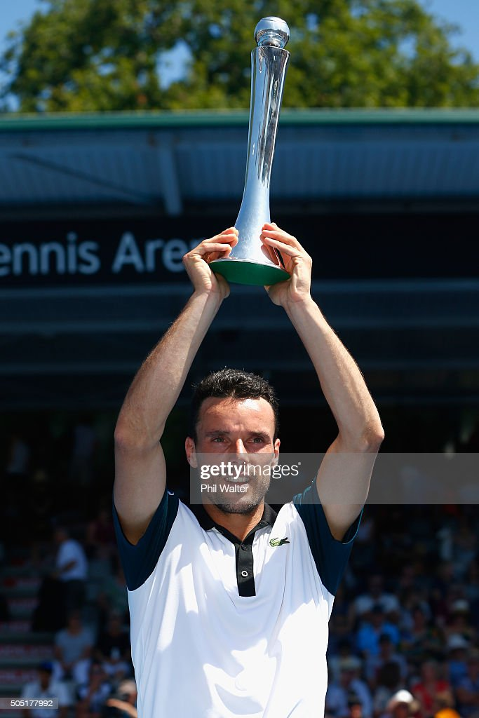 Roberto Bautista Agut of Spain poses with the trophy following his singles final against Jack Sock of the USA on day six of the ASB Classic at the Stanley Street Tennis Centre on January 16, 2016 in Auckland, New Zealand.