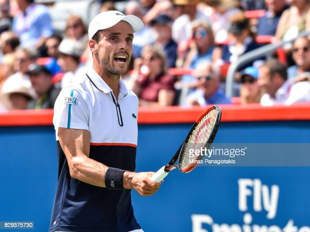 Roberto Bautista Agut of Spain reacts after losing a point against Gael Monfils of France during day seven of the Rogers Cup presented by National...