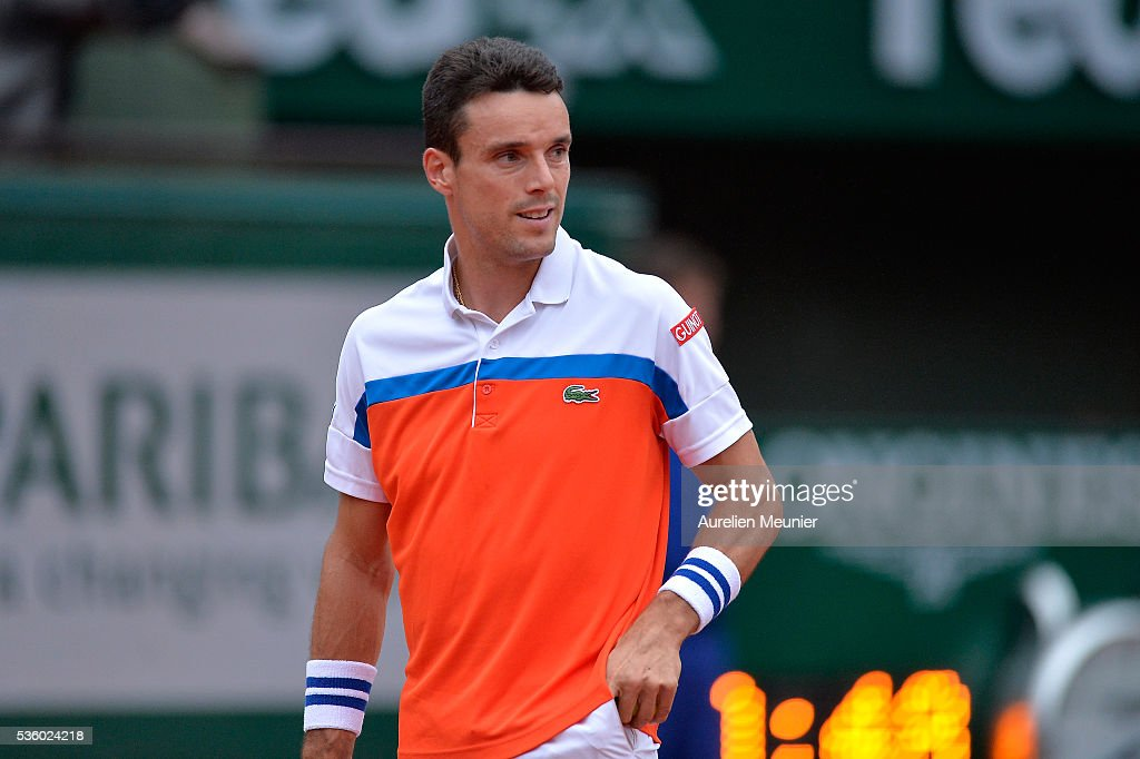 Roberto Bautista Agut of Spain reacts during his men's singles fourth round match against Novak Djokovic of Serbia on day ten of the 2016 French Open at Roland Garros on May 31, 2016 in Paris, France.