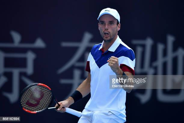 Roberto Bautista Agut of Spain reacts during his Men's singles quarterfinal match against Grigor Dimitrov of Bulgaria on day seven of the 2017 China...