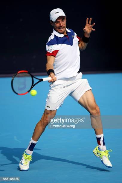 Roberto Bautista Agut of Spain returns a shot against Grigor Dimitrov of Bulgaria during the Men's Quarterfinal match on day seven of the 2017 China...