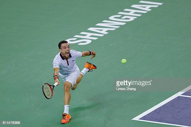 Roberto Bautista Agut of Spain returns a shot against JoWilfried Tsonga of France during the Men's singles quarterfinal match on day 6 of Shanghai...