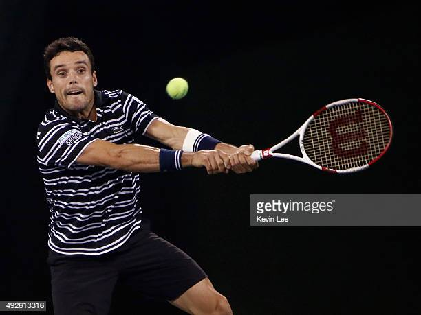 Roberto Bautista Agut of Spain returns a shot against Milos Raonic of Canada during their men's singles second round match on day 4 of Shanghai Rolex...