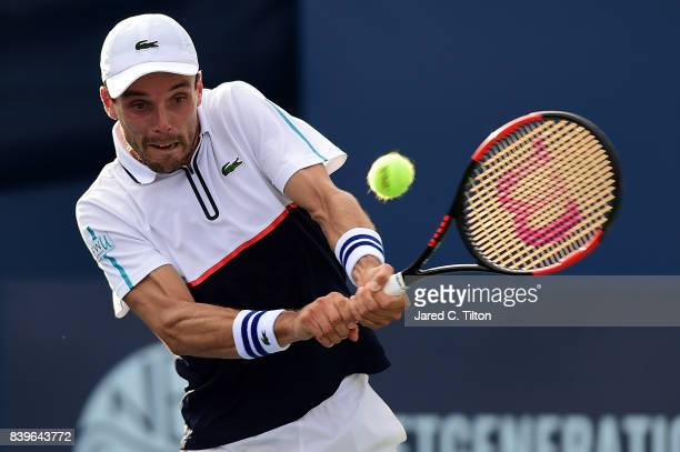 Roberto Bautista Agut of Spain returns a shot to Damir Dzumhur during the men's singles championship final of the WinstonSalem Open at Wake Forest...