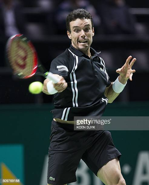 Roberto Bautista Agut of Spain returns the ball to Martin Klizan of Slovakia in the quarterfinals of the ABN AMRO World Tennis Tournament in...