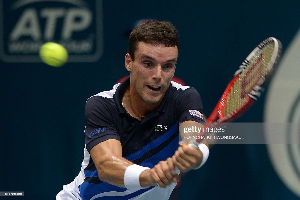 Roberto Bautista Agut of Spain returns to Tomas Berdych of Czechoslovakia during the second round of Tennis ATP Thailand Open 2013 tournament in Bangkok on September 25, 2013.