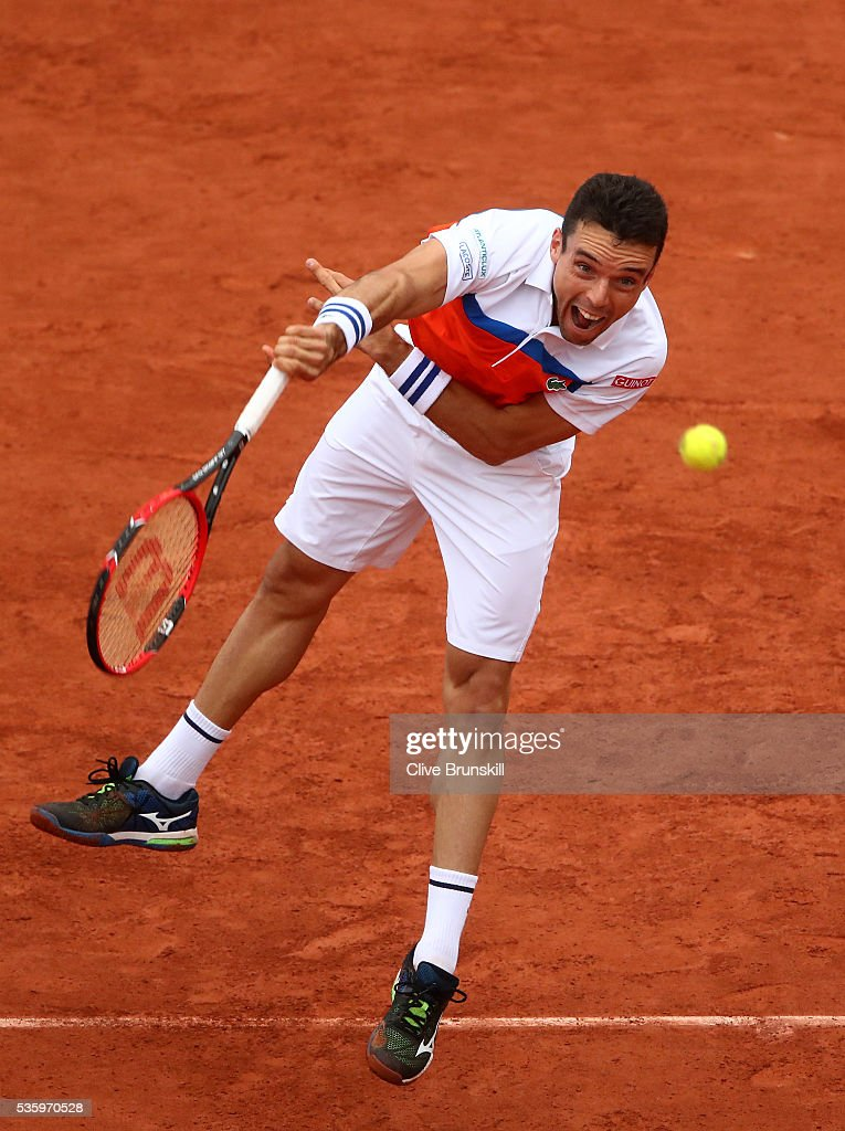 Roberto Bautista Agut of Spain serves during the Men's Singles fourth round match against Novak Djokovic of Serbia on day ten of the 2016 French Open at Roland Garros on May 31, 2016 in Paris, France.