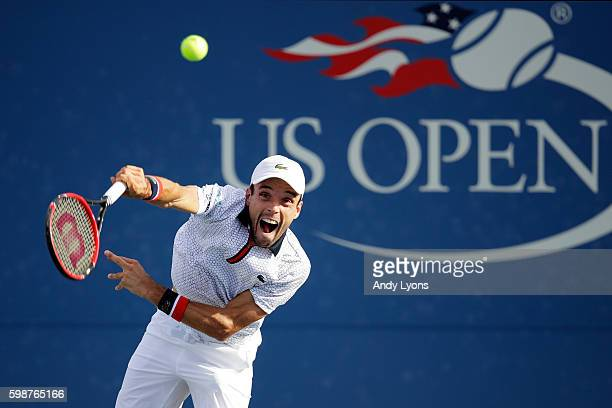 Roberto Bautista Agut of Spain serves to Lucas Pouille of France during his third round Men's Singles match on Day Five of the 2016 US Open at the...