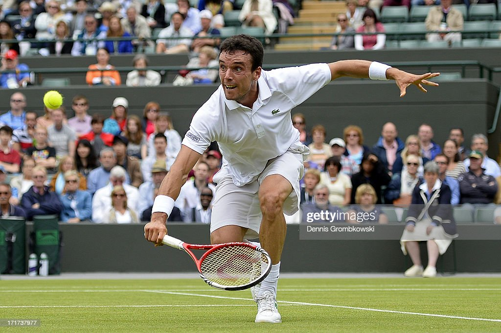 Roberto Bautista Agut of Spain volleys during his Gentlemen's Singles second round match against David Ferrer of Spain on day five of the Wimbledon Lawn Tennis Championships at the All England Lawn Tennis and Croquet Club on June 28, 2013 in London, England.