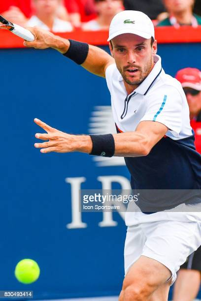 Roberto Bautista Agut returns the ball during his quarterfinal match at ATP Coupe Rogers on August 11 at Uniprix Stadium in Montreal QC