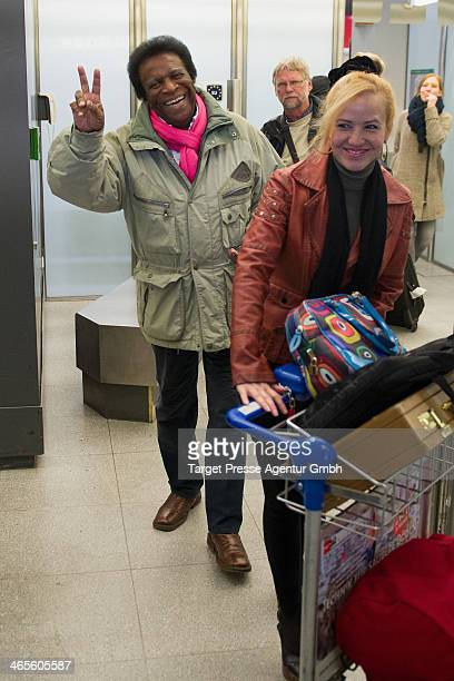 Roberto Blanco and his wife Luzandra arrive at Airport BerlinTegel on January 28 2014 in Berlin Germany