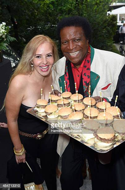 Roberto Blanco and his wife Luzandra Strassburg attend the 'El Gaucho' Restaurant Opening on September 5 2014 in Munich Germany