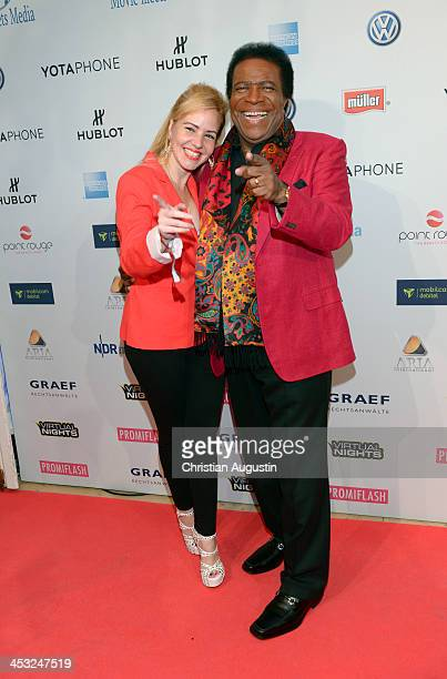 Roberto Blanco and Lauzandra Strassburg attend networking event 'Movie meets Media' at Hotel Atlantic on December 2 2013 in Hamburg Germany