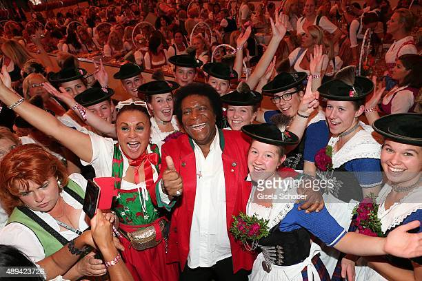 Roberto Blanco and sister Antonia Staudt attend the Regines Sixt Damen Wiesn during the Oktoberfest 2015 on September 21 2015 in Munich Germany