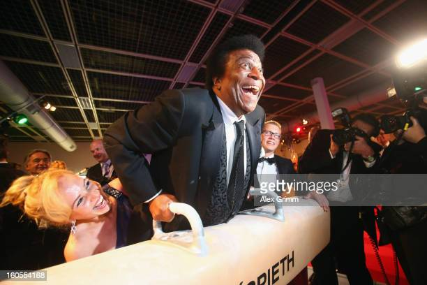 Roberto Blanco poses with Fabian Hambuechen and his wife Luzandra Strassburg during the 'Ball des Sports 2013' at RheinMainHallen on February 2 2013...