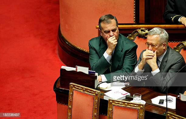 Roberto Calderoli Italy's minister for legislative simplification left and Giulio Tremonti Italy's finance minister attend a vote on debt reduction...