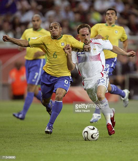 Roberto Carlos of Brazil and Frank Ribery of France battle for the ball during the FIFA World Cup Germany 2006 Quarterfinal match between Brazil and...