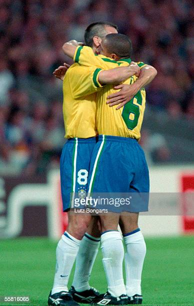 Roberto Carlos of Brazil celebrates with his team mate Dunga after scoring a goal from a free kick during the match between France and Brazil in the...