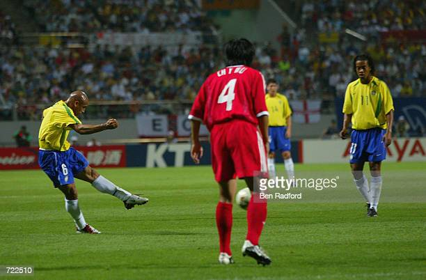 Roberto Carlos of Brazil scores the opening goal from a freekick during the FIFA World Cup Finals 2002 Group C match between Brazil and China played...