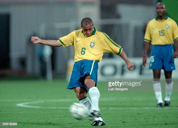 Roberto Carlos of Brazil takes a free kick during the match between France and Brazil in the Tournament de France at the Stadium de Gerland on June...