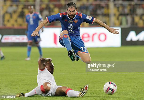 Roberto Carlos of Delhi Dynamos FC in action against Jofre Mateu Gonzalez of FC Goa during the 2nd match of Indian Super League 2015 at Jawaharlal...