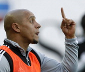 Roberto Carlos of FC Anzhi Makhachkala reacts from the sideline during the Russian Football League Championship match between FC Dynamo and FC Anzhi...