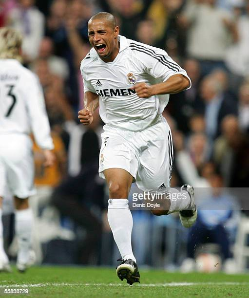 Roberto Carlos of Real Madrid celebrates after scoring a goal during a La Liga match between Real Madrid and Mallorca at the Bernabeu on October 2 in...