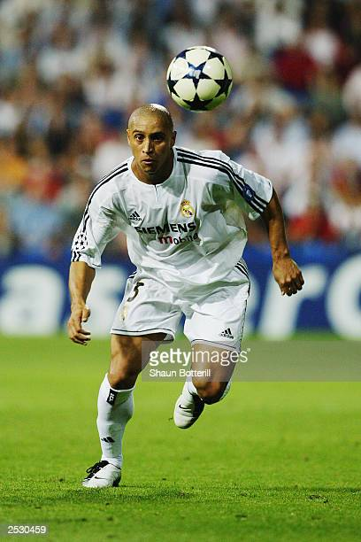 Roberto Carlos of Real Madrid chasing the ball during the UEFA Champions League Group F match between Real Madrid and Olympic Marseille on September...