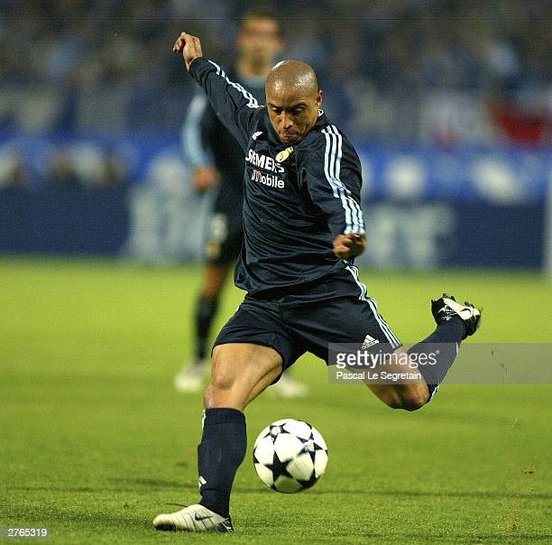 Roberto Carlos of Real Madrid in action during the UEFA Champions League Group F match between Marseille and Real Madrid at the Vellodrome on...