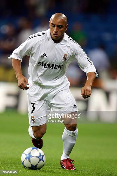 Roberto Carlos of Real Madrid in possession during a Santiago Bernabeu Trophy friendly soccer match between Real Madrid and a US Major League Soccer...