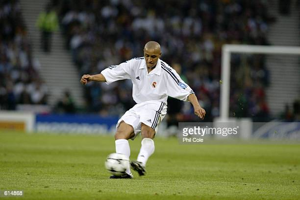 Roberto Carlos of Real Madrid passes the ball during the UEFA Champions League Final between Real Madrid and Bayer Leverkusen played at Hampden Park...