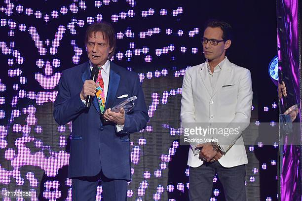 Roberto Carlos receives award by Marc Anthony at the 2015 Billboard Latin Music Awards presented bu State Farm on Telemundo at Bank United Center on...