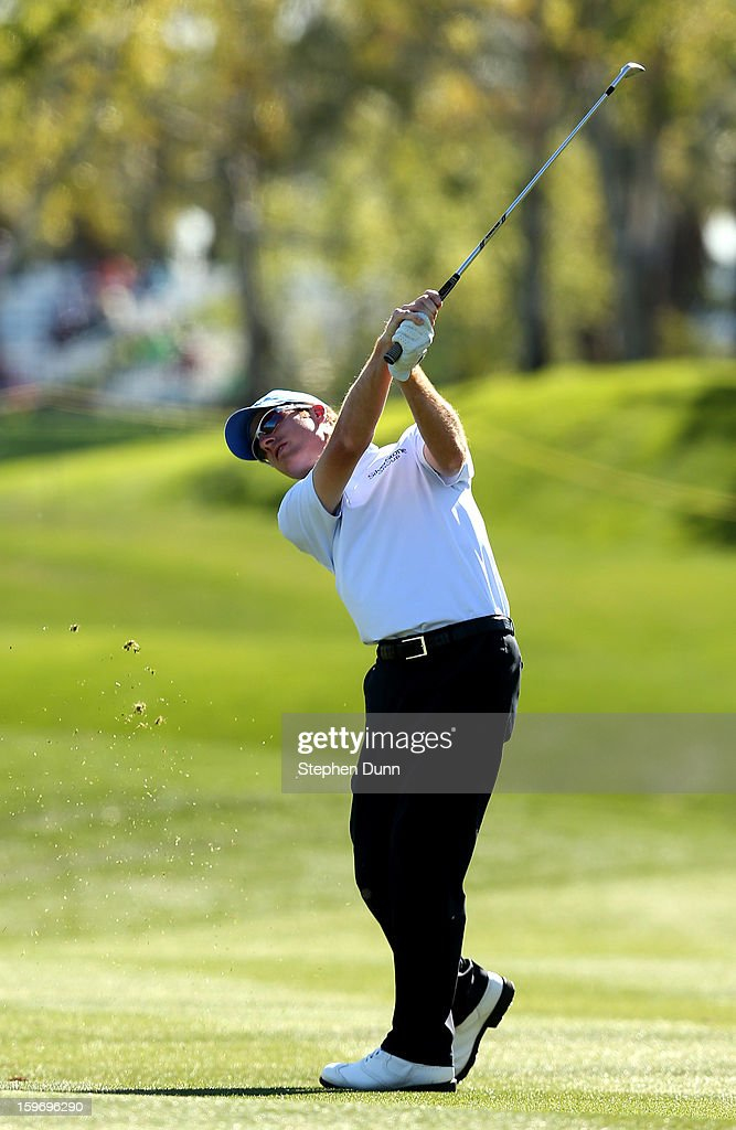 Roberto Castro hits his second shot on the first hole during the second round of the Humana Challenge In Partnership With The Clinton Foundation at the Palmer Private Course at PGA West on January 18, 2013 in La Quinta, California.