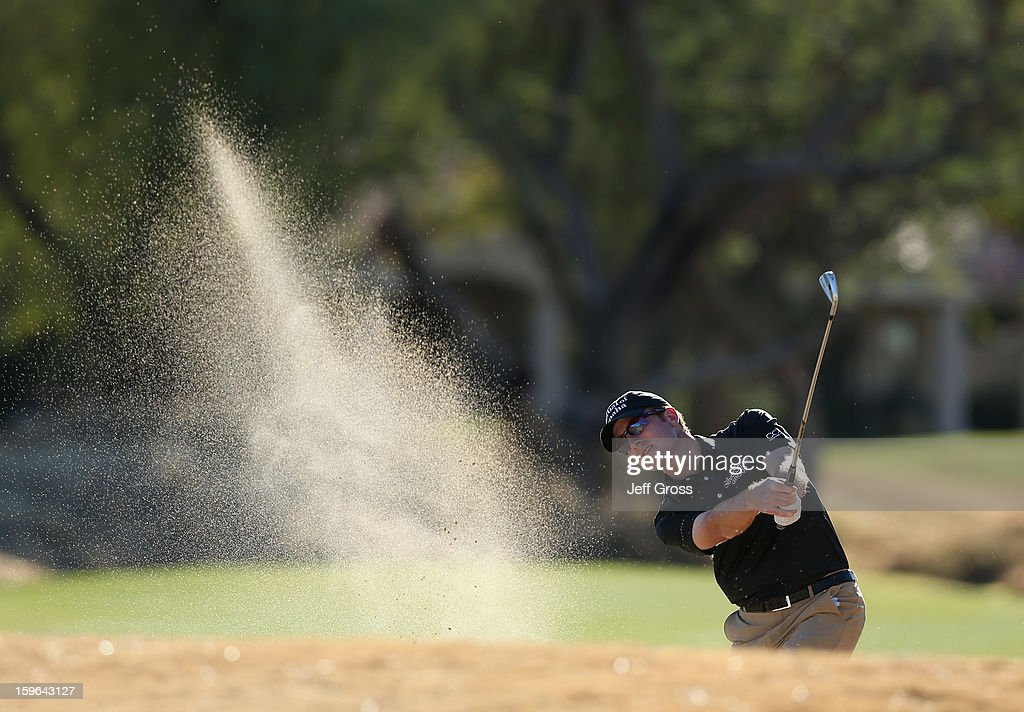 Roberto Castro plays a bunker shot from the 18th fairway at the Nicklaus Private Course at PGA West on January 17, 2013 in La Quinta, California.