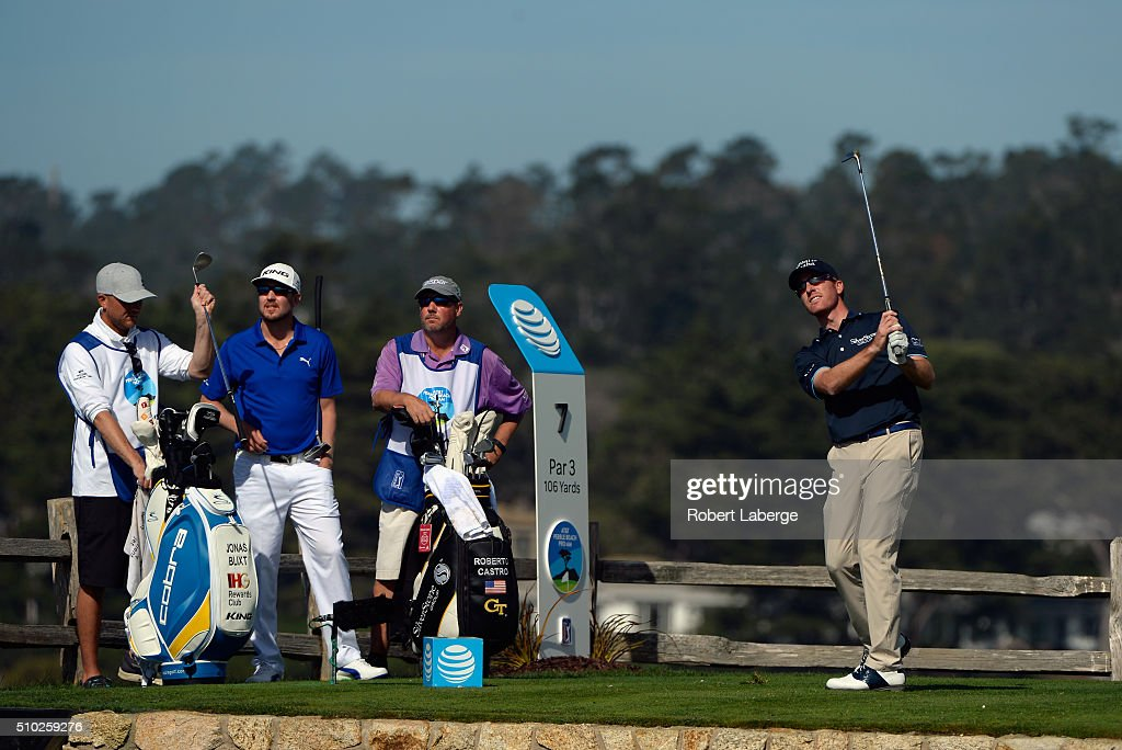Roberto Castro plays his tee shot on the seventh hole as Jonas Blixt of Sweden looks on during the final round of the AT&T Pebble Beach National Pro-Am at the Pebble Beach Golf Links on February 14, 2016 in Pebble Beach, California.