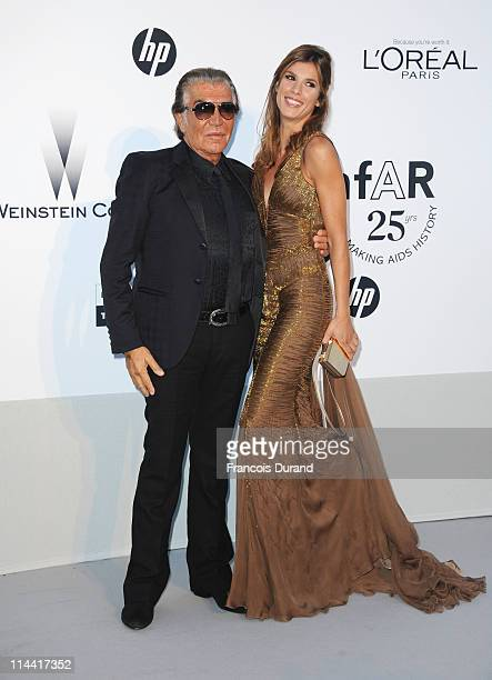 Roberto Cavalli and Elisabetta Canalis attend amfAR's Cinema Against AIDS Gala during the 64th Annual Cannes Film Festival at Hotel Du Cap on May 19...