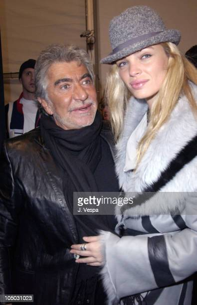 Roberto Cavalli and Esther Canadas during Mercedes Benz Fashion Week Fall 2003 Collections Luca Luca Front Row at Bryant Park in New York City New...
