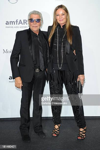 Roberto Cavalli and Eva Cavalli attend the amfAR Milano 2013 Gala as part of Milan Fashion Week Womenswear Spring/Summer 2014 at La Permanente on...