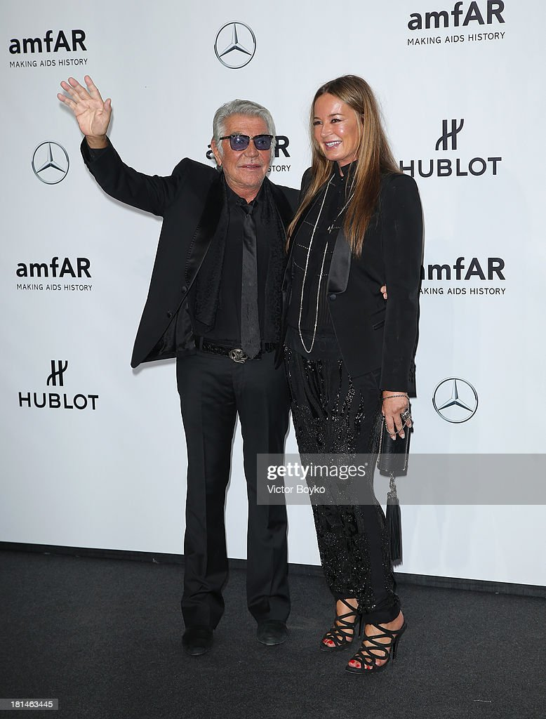 Roberto Cavalli and <a gi-track='captionPersonalityLinkClicked' href=/galleries/search?phrase=Eva+Cavalli&family=editorial&specificpeople=1719408 ng-click='$event.stopPropagation()'>Eva Cavalli</a> attend the amfAR Milano 2013 Gala as part of Milan Fashion Week Womenswear Spring/Summer 2014 at La Permanente on September 21, 2013 in Milan, Italy.