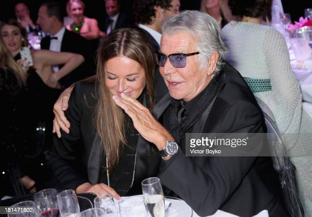 Roberto Cavalli and Eva Cavalli attend the amfAR Milano 2013 Gala Dinner as part of Milan Fashion Week Womenswear Spring/Summer 2014 at La Permanente...