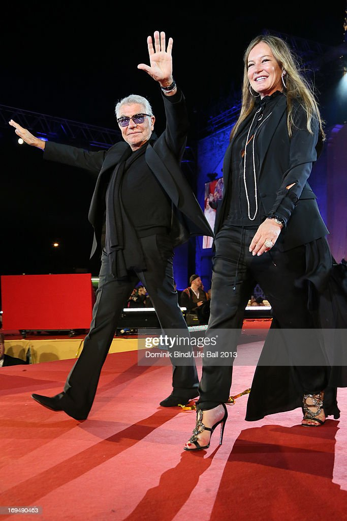 Roberto Cavalli and <a gi-track='captionPersonalityLinkClicked' href=/galleries/search?phrase=Eva+Cavalli&family=editorial&specificpeople=1719408 ng-click='$event.stopPropagation()'>Eva Cavalli</a> walk the catwalk after the fashion show at the 'Life Ball 2013 - Show' at City Hall on May 25, 2013 in Vienna, Austria.