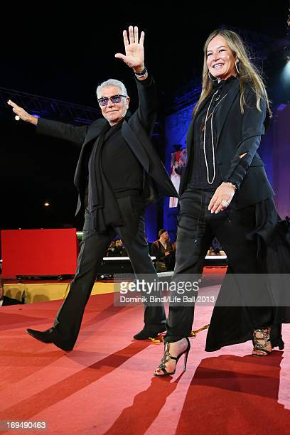 Roberto Cavalli and Eva Cavalli walk the catwalk after the fashion show at the 'Life Ball 2013 Show' at City Hall on May 25 2013 in Vienna Austria