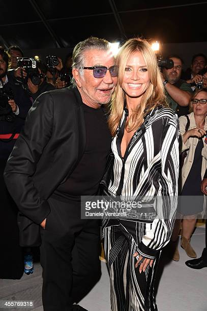 Roberto Cavalli and Heidi Klum attend the Roberto Cavalli Show as part of Milan Fashion Week Womenswear Spring/Summer 2015 on September 20 2014 in...