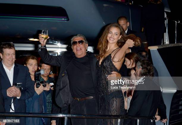 Roberto Cavalli and Irina Shayk attend the Roberto Cavalli yacht party at the 67th Annual Cannes Film Festival on May 21 2014 in Cannes France