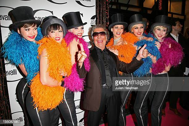Roberto Cavalli arrives at the Cavalli Party surrounded by Crazy Horse dancers on February 26 2008 in Paris France