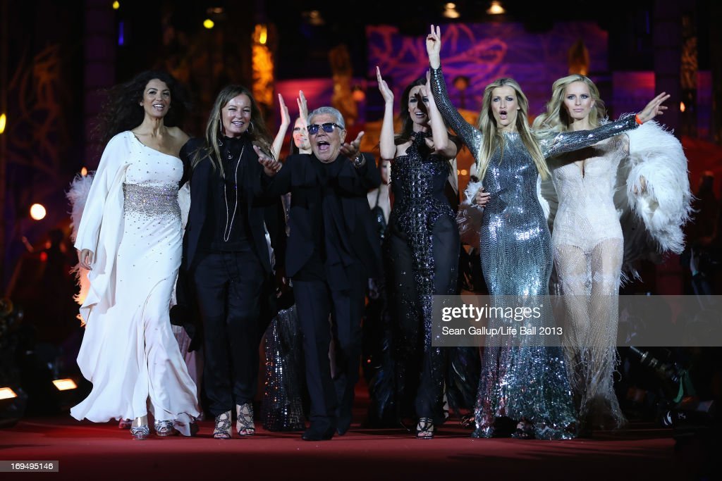 Roberto Cavalli, wife Eva and models walk the catwalk during the 'Life Ball 2013 - Show' at City Hall on May 25, 2013 in Vienna, Austria.