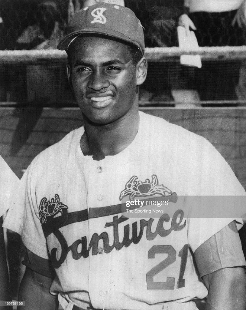 <a gi-track='captionPersonalityLinkClicked' href=/galleries/search?phrase=Roberto+Clemente&family=editorial&specificpeople=206918 ng-click='$event.stopPropagation()'>Roberto Clemente</a> #21 of the Cangrejeros de Santurce circa 1952 in Puerto Rico.