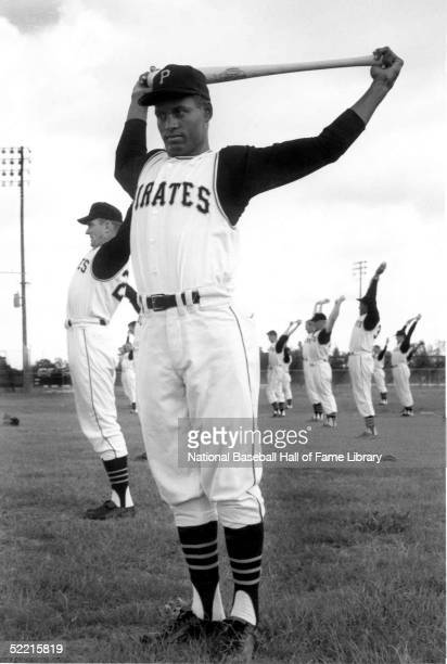 Roberto Clemente of the Pittsburgh Pirates stretches with a bat during spring training Clemente played for the Pirates from 195572