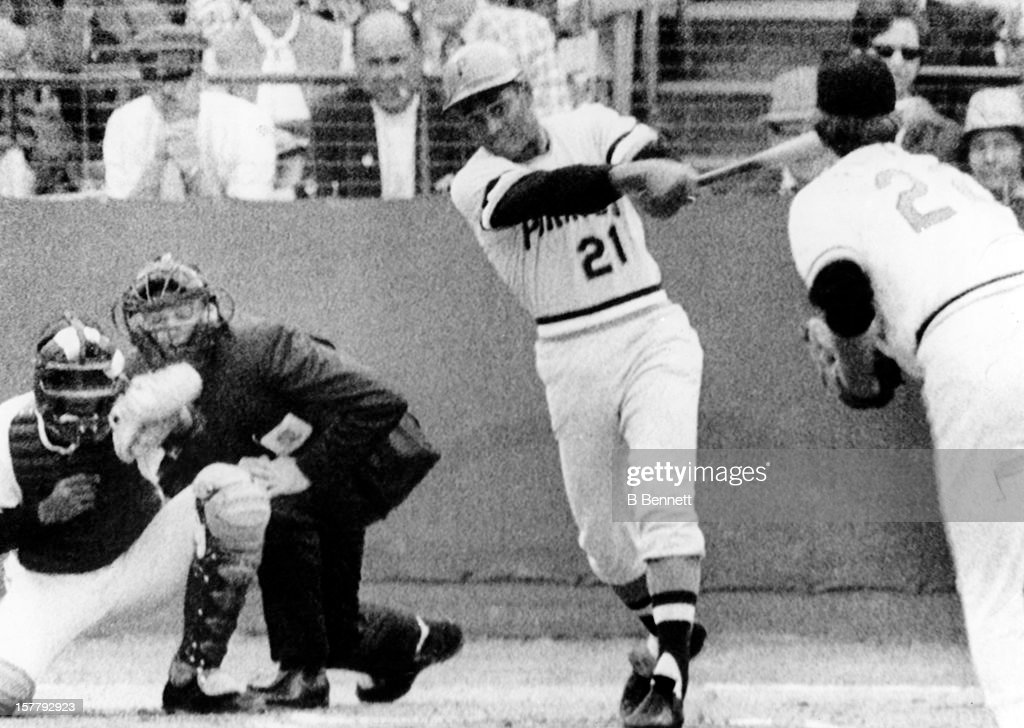 Roberto Clemente #21 of the Pittsburgh Pirates triples in the first inning off of pitcher Jim Palmer #22 of the Baltimore Orioles as catcher Elrod Hendricks #10 and umpire John Kibler look on during Game 6 of the 1971 World Series on October 16, 1971.
