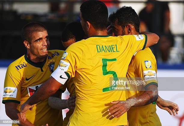 Roberto De Araujo of Brazil celebrates with teammates during the Samsung Beach Soccer Intercontinental Cup Dubai 2014 match between Brazil and the...